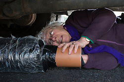 © Licensed to London News Pictures. 15/04/2019. London, UK. Sheila Collins from Cardiff,  Extinction Rebellion campaigner, attaches herself to the underneath of a vehicle at Marble Arch, during a day of coordinated actions and blockades throughout London and other UK cities to highlight global climate change. Photo credit: Sean Hawkey/LNP