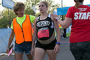 Trisha Byler finishes the Corporate Challenge on the campus of RIT on Tuesday, May 24, 2016.