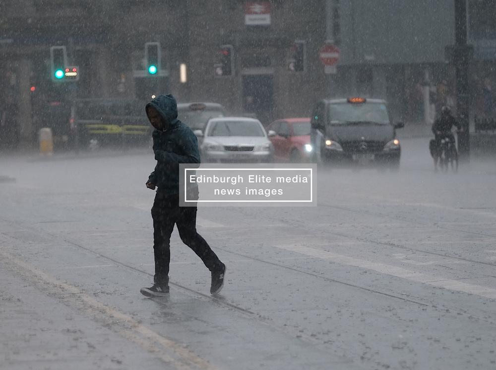 After the really hot weather, Edinburgh was hit by a thundestorm this evening<br /> <br /> Pictured: People in Haymarket hurry to escape the rain<br /> <br /> Alex Todd | Edinburgh Elite media