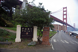 National Park Service welcome sign to Fort Point National Historical Park in front of the Golden Gate Bridge, San Francisco, California