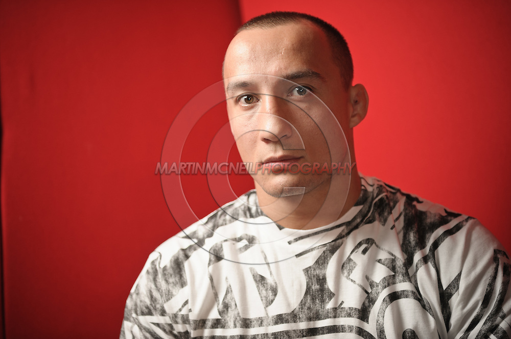 A portrait of mixed martial arts athlete Denis Kang