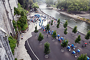 line of covered wheelchair carts waiting for the morning mass at the holy grotto in Lourdes France