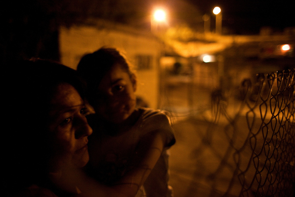 A mother holds her daughter in the Diaz Ordaz colonia in Ciudad Juarez, Chihuahua on May 14, 2010.