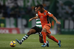 December 17, 2017 - Lisbon, Portugal - Sporting's forward Gelson Martins (L) vies for the ball with Portimonense's midfielder Paulinho during Primeira Liga 2017/18 match between Sporting CP vs Portimonense SC, in Lisbon, on December 17, 2017. (Credit Image: © Carlos Palma/NurPhoto via ZUMA Press)