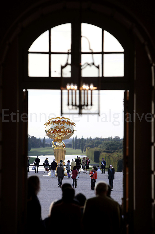 "Takashi Murakami 's ""Oval Buddha"" stands outside in the Chateau de Versailles garden. The exhibition of the Japanese artist will open from September 14  2010 until December 12 despite opposition from French traditionalists..13 september 2010.  Etienne de Malglaive"