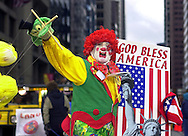 PHILADELPHIA - JANUARY 4: A member of the Purul  Comics Brigade struts on Market Street as he waves to the crowd during the 102nd Annual New Years Day Mummers Parade, January 4, 2003, in Philadelphia, Pennsylvania. The parade was postponed because of rain on New Years Day, the first time since 1990, and the 15th time in 40 years that the parade was postponed. (Photo by William Thomas Cain/Getty Images)