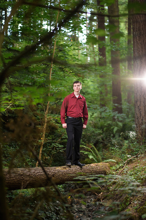 Mountlake Terrace, Washington - July 13, 2015: King Adam I stands in one of Uberstadt's colonies, Creekbed. &quot;The U.S. calls this area Veterans Memorial Park,&quot; King Adam I says of the forested park several blocks from the &Uuml;berstadti capitol Rosewood. <br /> <br /> The Creekbed Colony of &Uuml;berstadt borders the England-based micronation Austenasian's similar sized crown dependency, Oregonia. &Uuml;berstadt acts as the protectorate for the small swath of wooded land. <br /> <br /> The Kingdom of &Uuml;berstadt is led by nineteen-year-old King Adam I, (Adam Oberstadt). The Barony of Rosewood -- the micronation's capitol and the Oberstadt family home -- is nestled in the Seattle suburb of Mountlake Terrace, Wash. <br /> &Uuml;berstadt also claims territory of nearby Edmount Island on Lake Ballinger -- called The Barony of Ballinger and &quot;considered the spiritual homeland of the nation.&quot; Both baronies reside within the Duchy of Edmount which &quot;is situated entirely within the boundaries of the city of Mountlake Terrace, Washington,&quot; according to the &Uuml;berstadt website.<br /> &Uuml;berstadt  was founded by King Adam I and his high school friends March 6, 2010, and was governed by judges as a kritarchy. Before taking the crown, Adam was &Uuml;berstadt's chief judge. After graduation, many of the &Uuml;berstadti moved away to college and &Uuml;berstadt's populace shrank. Activities would shift from the high school to Rosewood, and the governing style morphed to a unitary constitutional monarchy. According to the micronation's website &Uuml;berstadt is a sovereign state &quot;guided by the principles of direct democracy, socialist economics, and environmentalism.&quot; <br /> <br /> CREDIT: Matt Roth
