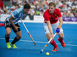 England's Ollie Willars is watched by Ignacio Ortiz of Argentina. England v Argentina - Hockey World League Semi Final, Lee Valley Hockey and Tennis Centre, London, United Kingdom on 18 June 2017. Photo: Simon Parker