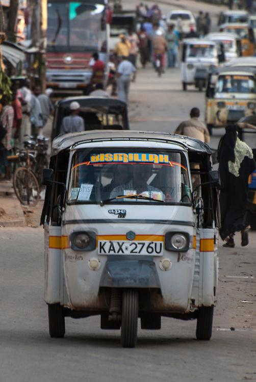 Tuk Tuks driving through the streets of Malindi, Malindi, Kenya