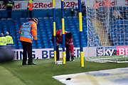 Stewards deal with a blue flair that had been thrown onto the pitch during the EFL Sky Bet Championship match between Leeds United and Millwall at Elland Road, Leeds, England on 20 January 2018. Photo by Craig Zadoroznyj.