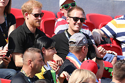 Prince Harry had fun with a member of the crowd at the York Stadium by taking his scarf from him then giving it back whilst watching the first day of athletics at the York Stadium Toronto on day two of the 2017 Invictus games Toronto<br /><br />24 September 2017.<br /><br />Please byline: Vantagenews.com