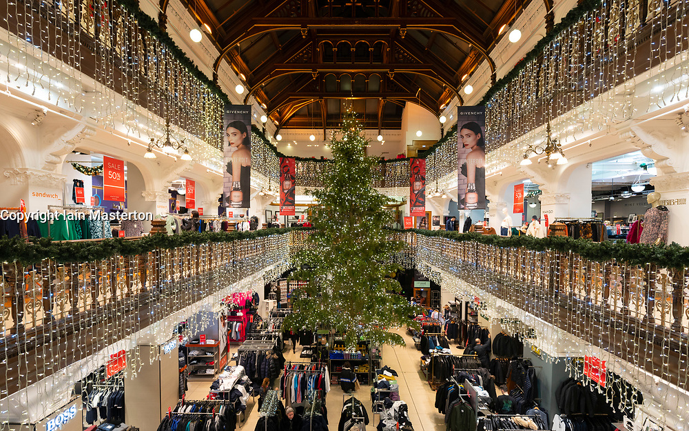 view of Christmas tree and decorations in atrium of Jenners department store on Princes Street in Edinburgh, Scotland, Uk