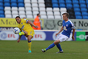 Battle of the Captain, AFC Wimbledon defender & captain Barry Fuller (2) and Peterborough United midfielder & captain Chris Forrester (8) during the EFL Cup match between Peterborough United and AFC Wimbledon at ABAX Stadium, Peterborough, England on 9 August 2016. Photo by Stuart Butcher.
