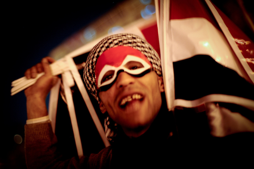 A man sells Egyptian flags at night to protesters in Tahrir Square.