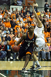 19 March 2010: Philana Greene dribbles out of the paint. The Flying Dutch of Hope College defeat the Yellowjackets of the University of Rochester in the semi-final round of the Division 3 Women's Basketball Championship by a score of 86-75 at the Shirk Center at Illinois Wesleyan in Bloomington Illinois.