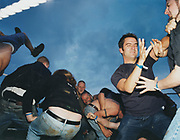 Young men in a mosh pit.