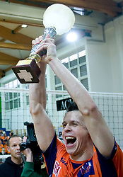 Matija Plesko celebrates with a Cup at last final volleyball match between OK ACH Volley and Salonit Anhovo, on April 21, 2009, in Arena SGS Radovljica, Slovenia. ACH Volley won the match 3:0 and became Slovenian Champion. (Photo by Vid Ponikvar / Sportida)