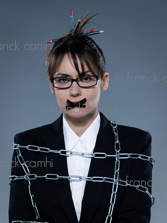 beautiful business woman chained on isolated background
