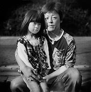 Katsuyuki Sato, 36 years old, was at the Fukushima Daiichi nuclear power plant during the earthquake. He is from Okuma-Machi, Futaba-gun, Fukushima Prefecture, Japan.  He has evacuated with his family to Higashiyama Grand Hotel, Aizwakamatsu-City, Fukushima Prefecture, Japan.  He is photographed with his daughter..