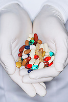 Lab Worker with Hands Full of coloured Pills