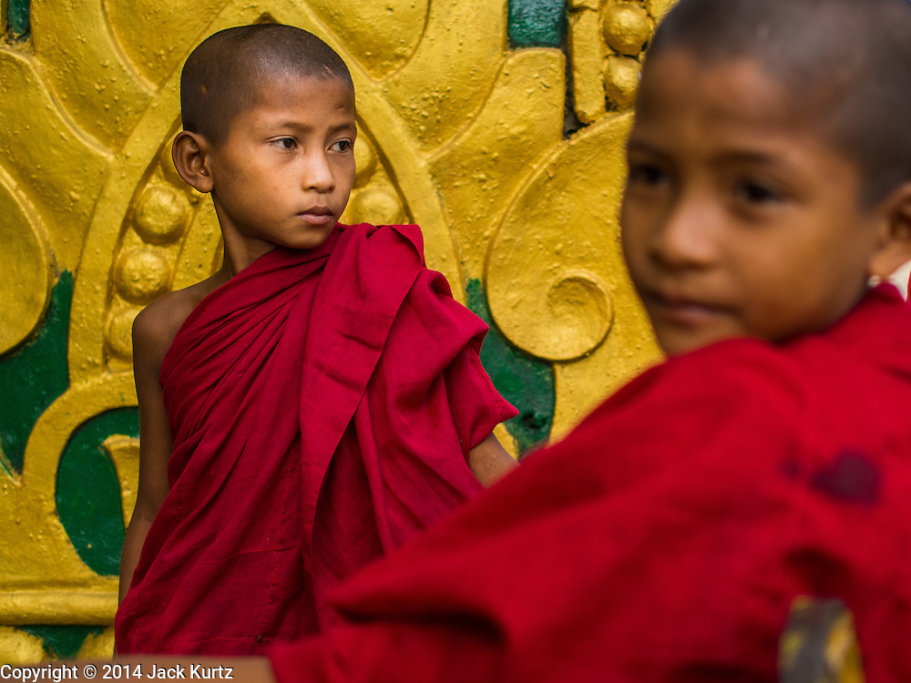 10 NOVEMBER 2014 - SITTWE, MYANMAR: Buddhist novices (young monks) in Sittwe, Myanmar. Most Burmese males enter the Sangha (Buddhist monkhood) for at least a short period of their lives. Sittwe is a small town in the Myanmar state of Rakhine, on the Bay of Bengal.    PHOTO BY JACK KURTZ
