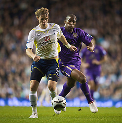 LONDON, ENGLAND - Tuesday, October 27, 2009: Tottenham Hotspur's Roman Pavlyuchenko in action against Everton's Sylvain Distin during the League Cup 4th Round match at White Hart Lane. (Photo by David Rawcliffe/Propaganda)