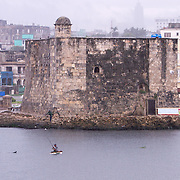 Fishermen looking for a catch near the mouth the river Almendares in front of the Torreón de la Chorrera (Tower of la Chorrera), a Spanish fort built in 1646. Fishing is not only a favorite pastime for Cubans but it is also an income source. <br /> Photography by Jose More