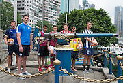 HKFC Citi Soccer Sevens Press conference at the historic Noon Day gun on Victoria Harbour Hong Kong. The one shot salute is a long standing Hong Kong tradition. Leicester City player Elliott Moore prepares to fire the gun.Players L to R- HKFC Gary Gheczy,Leicester City Elliott Moore, Aston Villa Khalid Abdo, West Ham Lewis Page, Stoke City Lewis Banks, Wellington Phoenix Justin Gulley and Newcastle United Dan Barlaser.
