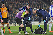Keiren Westwood of Sheffield Wednesday receives attention for an injury during the Sky Bet Championship match between Hull City and Sheffield Wednesday at the KC Stadium, Kingston upon Hull, England on 26 February 2016. Photo by Ian Lyall.