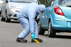 © Licensed to London News Pictures. 28/05/2019. London, UK.A forensic officer places a marker on Dyson Road, Forest Gate, East London where a man in his 30s died in the early hours of this morning following a flight on Warwick Road.<br />