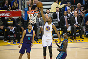 Golden State Warriors forward Kevin Durant (35) dunks the ball against the Charlotte Hornets at Oracle Arena in Oakland, Calif., on February 1, 2017. (Stan Olszewski/Special to S.F. Examiner)