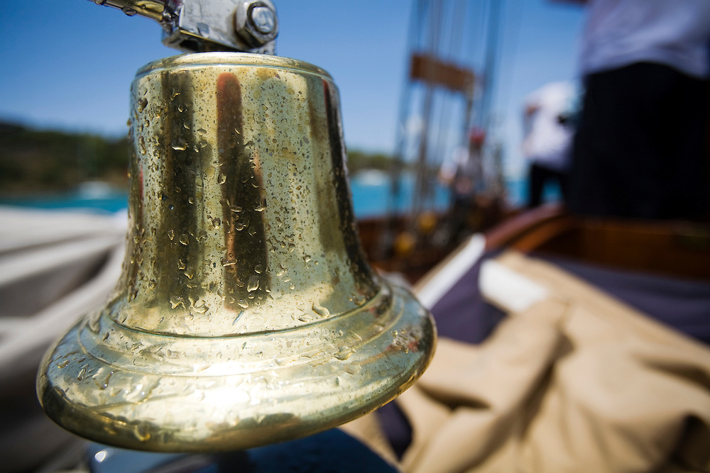 The ships bell on board the schooner yacht SY Altair during the 2008 Antigua Classic Yacht Regatta . This race is one of the worlds most prestigious traditional yacht races. It takes place annually off the cost of Antigua in the British West Indies. Antigua is a yachting haven, historically a British navy base in the times of Nelson.
