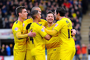 Oxford players celebrate their opening goal to give them a 1-0 lead during the Sky Bet League 2 match between Plymouth Argyle and Oxford United at Home Park, Plymouth, England on 5 March 2016. Photo by Graham Hunt.
