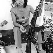 Managua, Nicaragua 1984. Martha Lorena on guard duty outside the main telecommunications office.