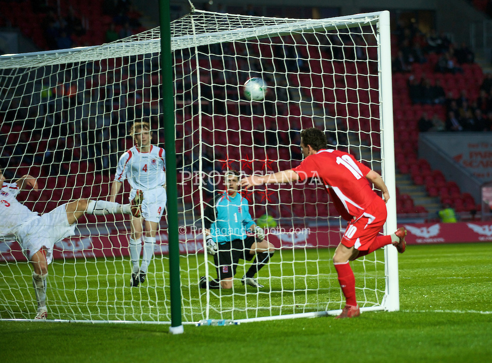 LLANELLI, WALES - Tuesday, March 31, 2009: Wales' Jonathan Brown scores the second goal against Luxembourg during the UEFA Under-21 Championship Group 3 match at Parc-Y-Scarlets. (Pic by David Rawcliffe/Propaganda)