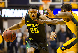 Feb 6, 2016; Morgantown, WV, USA; Baylor Bears guard Al Freeman (25) drives against West Virginia Mountaineers guard Daxter Miles Jr. (4) during the first half at the WVU Coliseum. Mandatory Credit: Ben Queen-USA TODAY Sports