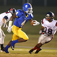 Adam Robison | BUY AT PHOTOS.DJOURNAL.COM<br /> Booneville's Dallas Gamble gains yards on the Nettleton defense.