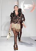 Models wearing Baby Phat work the runway at Funkshion Fashion Week show Wednesday, March 22, 2006 in Miami, Florida.
