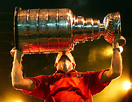 Story:  In the hometown of retired Red Wings goaltender Dominik Hasek thousands gather for a day-long festival to celebrate Lord Stanley's Cup being braught to the Czech Republic.<br /> Date: Friday August 16, 2002<br /> Caption:At the conclusion of the Stanley Cup and Dominik Hasek day-long festival in Pardubice, Hasek's hometown 100 kilometers east of Prague,  retired Wings goaltender Dominik Hasek kisses the Cup  while he  celebrates the Wing's Stanley Cup victory for thousands of fans gathered at the rally. The end of the championship game was being played on a big screen television to the delight of the crowsd.