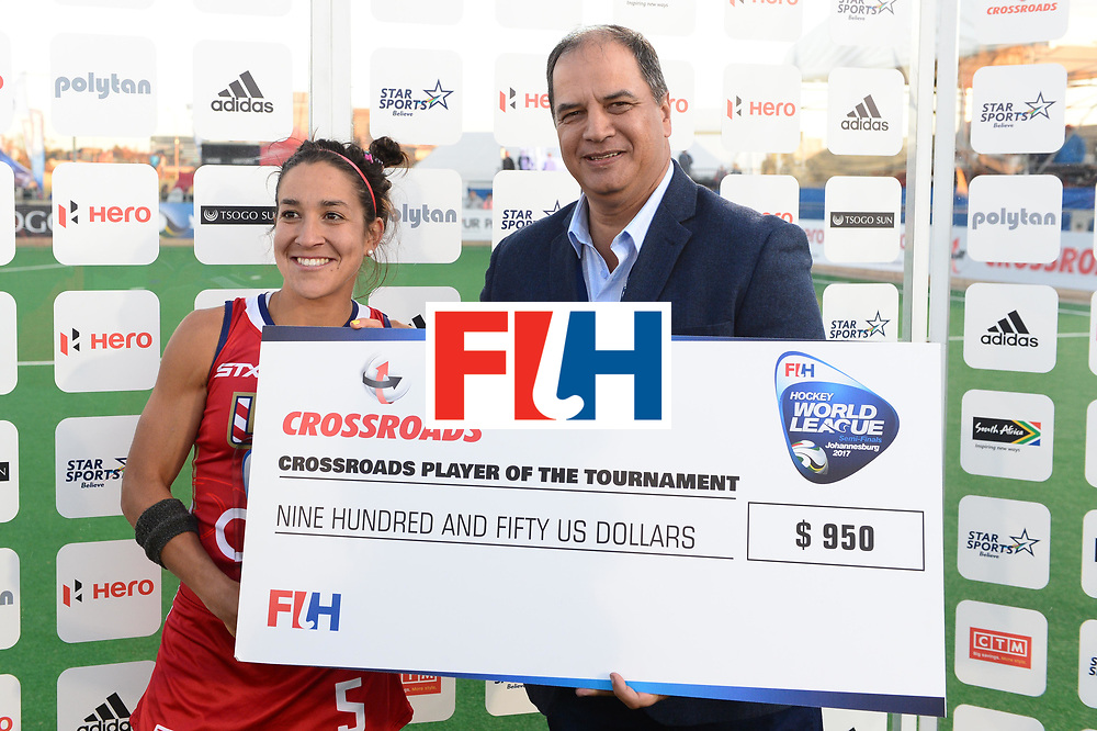 JOHANNESBURG, SOUTH AFRICA - JULY 23: Best Player, Melissa Gonzalez of United States of America receives her award from CFO CROSSROADS, Pieter Du Plessis during day 9 of the FIH Hockey World League Women's Semi Finals, final  match between United States and Germany at Wits University on July 23, 2017 in Johannesburg, South Africa. (Photo by Getty Images/Getty Images)