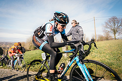 Club riders mixed in with the elites sees big gaps appear on Paterberg.