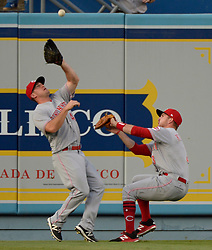 June 10, 2017 - Los Angeles, California, U.S. - Cincinnati Reds second baseman Scooter Gennett (4) catches a RBI sac fly ball by Los Angeles Dodgers' Adrian Gonzalez (not pictured) as he almost collides with teammate right fielder Scott Schebler (43) as Corey Seager (not pictured) scores on the play in the first inning of a Major League baseball game at Dodger Stadium on Saturday, June 10, 2017 in Los Angeles. (Photo by Keith Birmingham, Pasadena Star-News/SCNG) (Credit Image: © San Gabriel Valley Tribune via ZUMA Wire)