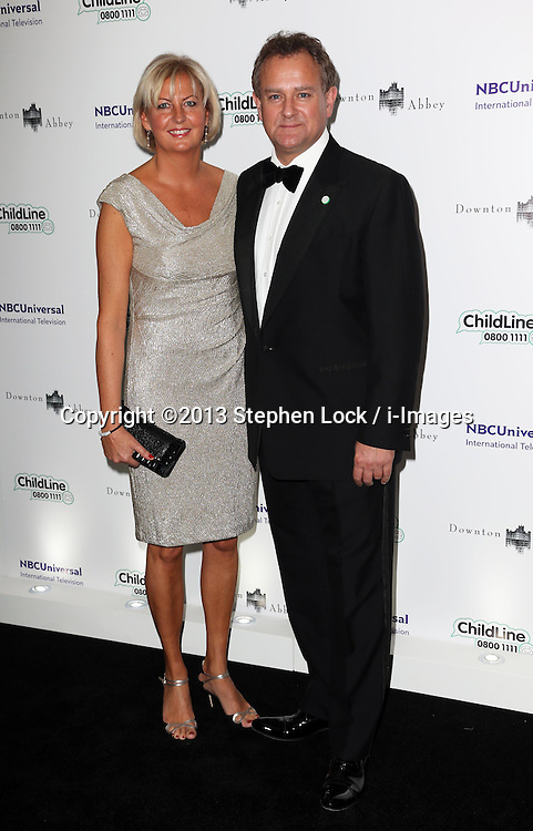 Hugh Bonneville and wife Lulu Williams  arriving at the Downton Abbey ChildLine Ball in London, Thursday, 24th October 2013. Picture by Stephen Lock / i-Images