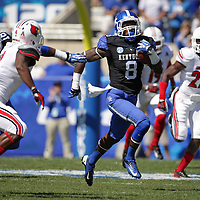 UK linebacker Josh Forrest gains some long yardage in the first quarter as the University of Kentucky plays the University of Louisville at Commonwealth Stadium in Lexington, Ky. Saturday Sept. 14, 2013. Photo by David Stephenson