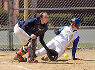 Middletown, NY - Jessica Vance of Gloucester County College slides home at SUNY Orange catcher Jennifer Stefanowicz takes the throw during a women's softball game on March 29, 2008.