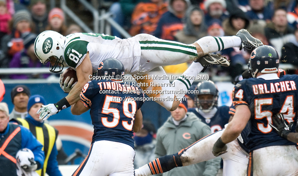 December 26, 2010: New York Jets at Chicago Bears at Soldier Field in Chicago, IL -  NY Jets lose to the Chicago Bears 38-34. #81 Dustin Keller flys through the air during the second half as he tries to hurdle a player for extra yards.