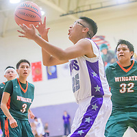 Miyamura Patriot Gabrian Lee (25) catches a pass in the paint at Miyamura High School in Gallup Tuesday.