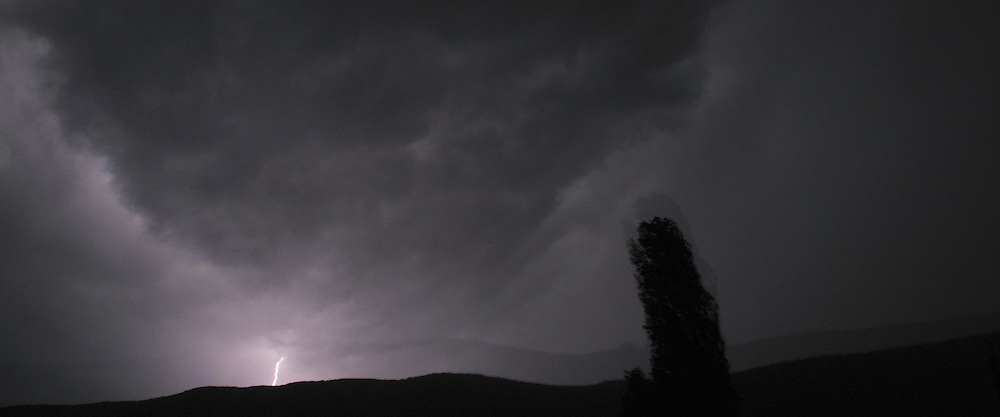 Thunder storm and Lightening bolt over Galicica mountain range, Galicica National Park, Macedonia. View South towards Konjsko. Lombardy Poplar, Populus nigra, in foreground.<br /> Stenje region, Lake Macro Prespa (850m) <br /> Galicica National Park, Macedonia, June 2009<br /> Mission: Macedonia, Lake Macro Prespa /  Lake Ohrid, Transnational Park<br /> David Maitland / Wild Wonders of Europe