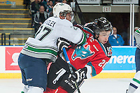 KELOWNA, CANADA - MARCH 18: Evan Wardley #27 of Seattle Thunderbirds checks Gage Quinney #20 of Kelowna Rockets  on March 18, 2015 at Prospera Place in Kelowna, British Columbia, Canada.  (Photo by Marissa Baecker/Shoot the Breeze)  *** Local Caption *** Evan Wardley; Gage Quinney;