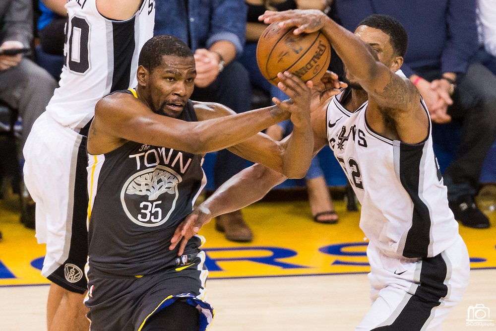 San Antonio Spurs forward Rudy Gay (22) strips the ball from Golden State Warriors forward Kevin Durant (35) during Game 2 of the Western Conference Quarterfinals at Oracle Arena in Oakland, Calif., on April 16, 2018. (Stan Olszewski/Special to S.F. Examiner)